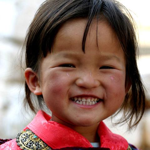 Strahlendes Lachen im Land des Glücks, Bhutan