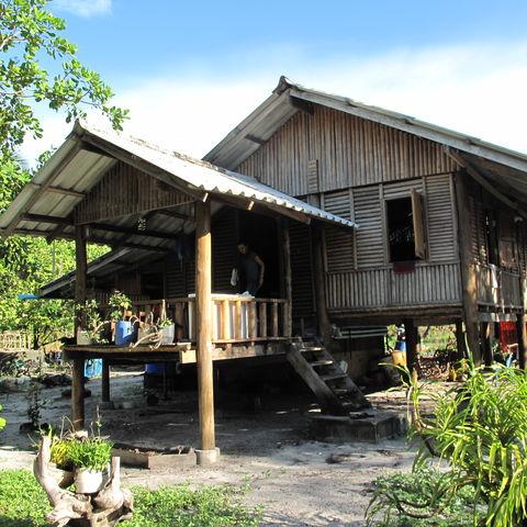 Die Dorfhütte einer Familie des Projektes, Thailand