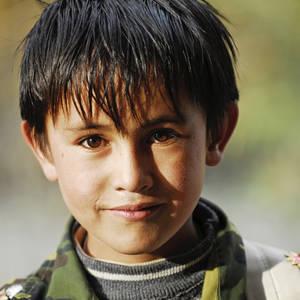 Lächelnder tadschikischer Junge © Thinkstock, iStockphoto